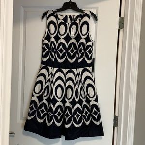 The limited navy and white pattern dress